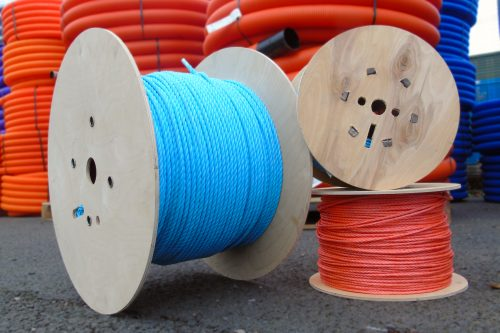 Blue & Orange Polypropylene Rope On Plywood Reels With Plastic Tubing In Background
